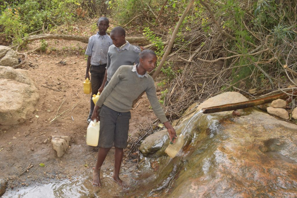 The Water Project : kenya19253-filling-container-with-water