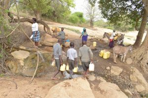 The Water Project:  Students And Community Members Fetching Water