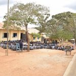 The Water Project: Kithoni Primary School -  Students Gathered Outside