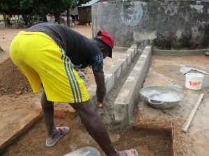 The Water Project:  Cementing The Water Collection Area