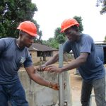 The Water Project: Lungi Town, 112 Alimamy Seray Modu Road -  Installing The Pump
