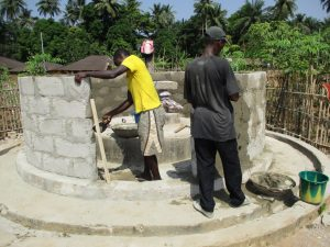 The Water Project:  Completing The Well Pad