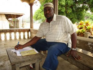 The Water Project:  Pa Alimamy Kamara Auditor Wash Committee Signs The Contract