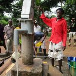The Water Project: Mondor Community -  Pumping Well After Pump Installation Is Complete