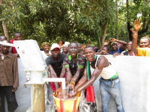 The Water Project:  Young Men Celebrate The Well