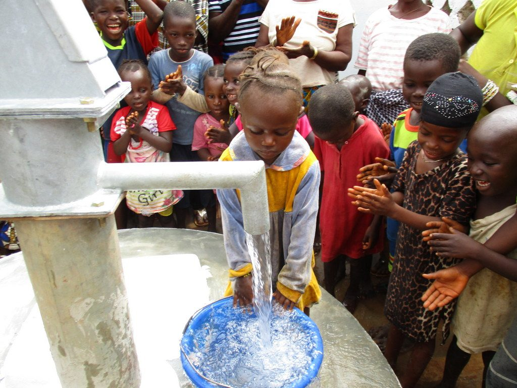 The Water Project : sierraleone18288-filling-container-with-water