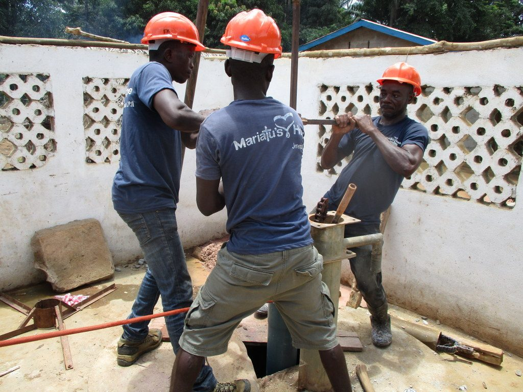 The Water Project : sierraleone18288-team-using-hand-drill