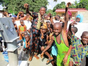The Water Project:  Kids Pose At The Well