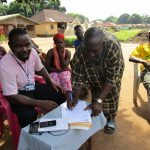 The Water Project: Lungi Town, 112 Alimamy Seray Modu Road -  Water Committee Members Sign Agreement To Care For The Well