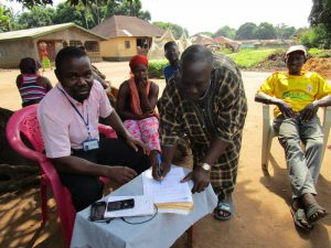 The Water Project:  Water Committee Members Sign Agreement To Care For The Well