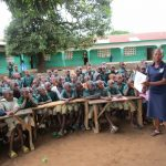 The Water Project: Kamasando DEC Primary School -  Students Listening To Instruction On Hygiene And Sanitation
