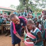 The Water Project: Kamasando DEC Primary School -  Tooth Brushing Demonstration