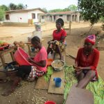 The Water Project: Tholmossor, Amputee Camp -  Women Sorting Produce