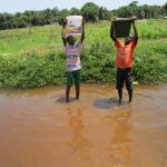 The Water Project: Lungi, Suctarr, 10 Khalil Lane -  Boys Lift Water To Carry Home