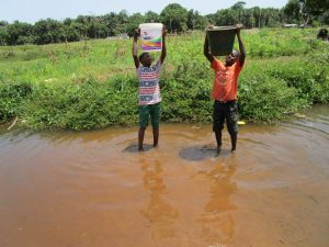 The Water Project:  Boys Lift Water To Carry Home