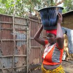 The Water Project: Targrin Health Post -  Carrying Water