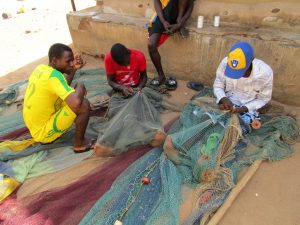 The Water Project:  Fishermen Reparing Their Nets