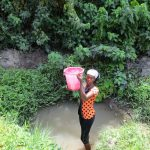 The Water Project: Targrin Health Post -  Hauling Water From Unprotected Spring