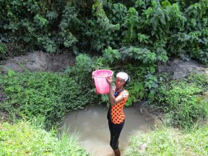 The Water Project:  Hauling Water From Unprotected Spring