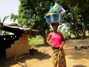 The Water Project:  Woman Carries Containers At Household
