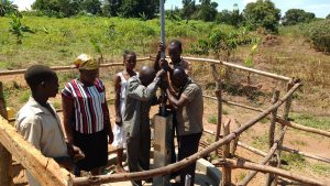 The Water Project:  Community Members Contribute To Well Construction