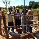The Water Project: Hamis Water Source Pakanyi Community -  Inserting Well Rods