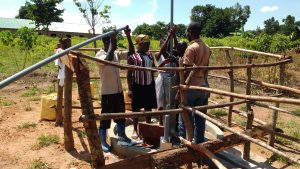 The Water Project:  Inserting Well Rods