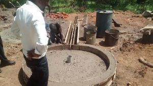 The Water Project:  Setting Cement For Well Pad
