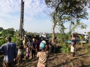 The Water Project:  Community Members Greert The Drill Rig