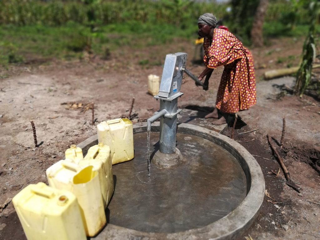 The Water Project : uganda18295-pumping-water