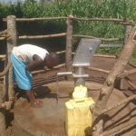 The Water Project: Kyamudikya Community A -  Drinking Water From The Well