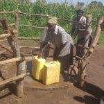 The Water Project: Kyamudikya Community A -  Fetching Water At The Well