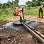 The Water Project: Kyamudikya Community A -  Water Flows From New Depth
