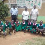 The Water Project: Kigulienyi Primary School -  Students And Staff Posing