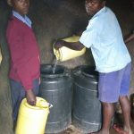 The Water Project: Kapkemich Primary School -  Delivering Some Water To Kitchen