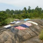 The Water Project: Eshiakhulo Community, Asman Sumba Spring -  Clothes Drying On Ground