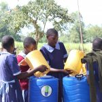 The Water Project: Shihimba Primary School -  Filling The New Handwashing Stations