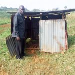 The Water Project: Imbinga Community, Arunga Spring -  Festus Showing Us The Family Latrine