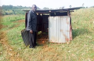 The Water Project:  Festus Showing Us The Family Latrine