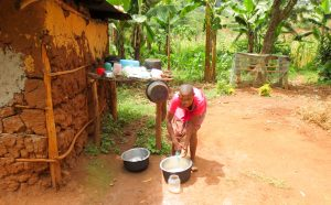 The Water Project:  Agness Using Spring Water To Wash Dishes