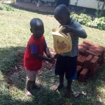 The Water Project: Asimuli Community, John Omusembi Spring -  Handwashing With Leaky Tin