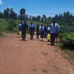 The Water Project: Musasa Secondary School -  Carrying Water Back To School