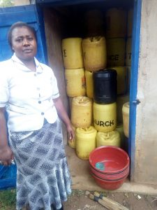 The Water Project:  Madam Shuah At Water Storage Latrine