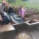 The Water Project: Shirugu Community, Jeremiah Mashele Spring -  Backfilling