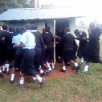 The Water Project: Hombala Secondary School -  Girls Rushing For Latrines