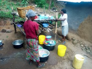 The Water Project:  Women Washing Utensils
