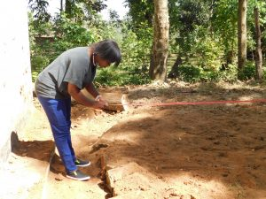 The Water Project:  Measuring For Tank Foundation