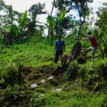 The Water Project: Koloch Community, Solomon Pendi Spring -  Delivering Stones