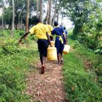 The Water Project: Ibwali Primary School -  Carrying Water Back To School
