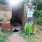 The Water Project: Shisere Community, Richard Okanga Spring -  Josephine Next To A Dangerous Latrine